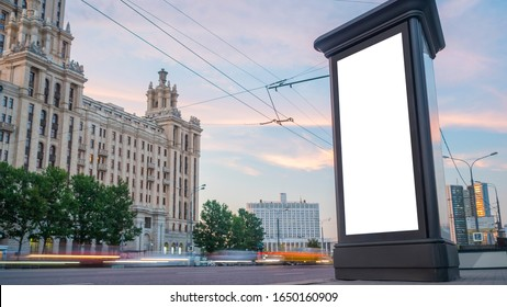 Consumerism, mockup, isolated white screen, template, background, copyspace concept. Mock up image - blank vertical street white billboard poster or advertising pillar and fast moving car at sunset