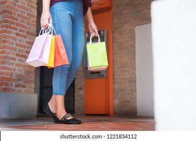 consumerism woman holding many shopping bags in fashion boutiqueafter buying presents ,enjoying sale and people concept