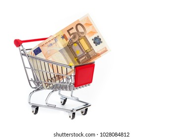Consuming concept with shopping cart and 50 euro bill inside