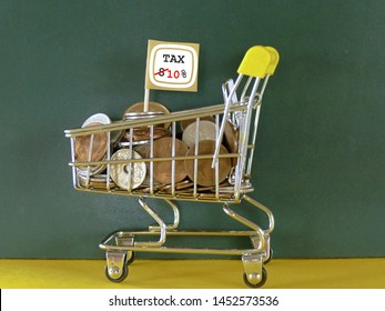 consumption tax 10% will be applied in order to find tax revenue for japan government. The photo of stroller with a pile of Japanese  coins and the small flag written about tax rate