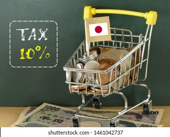 consumption tax word with a lot of Japanese coin and 100 yen bills under.  the monetary economic concept. Japan will raise the tax to10%  in 2019