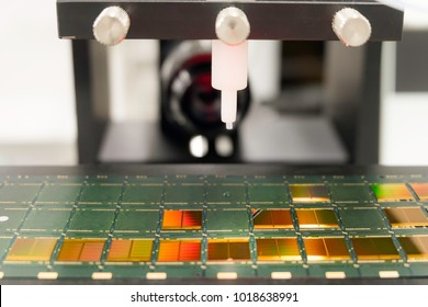 contact angle measurement, silicon wafers each in die attach on substrate in semiconductor manufacturing, reflecting colors, select focus