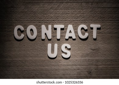 Contact concept wood letters on wooden background