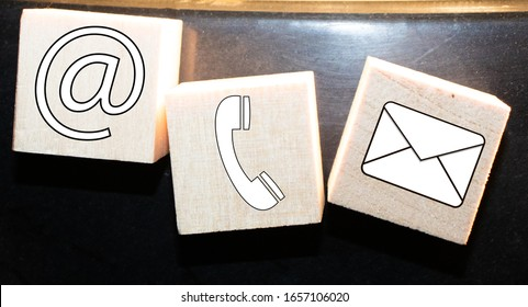 Contact Icons Letter Email Message Phone Concept on a wooden background