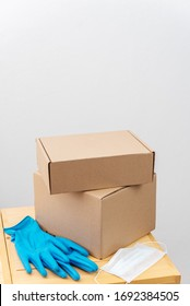 Contact less delivery concept, safe shipment, courier with carboard box, order from online shop.