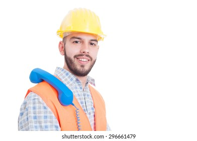 Contact person for construction company waiting a call with phone on shoulder