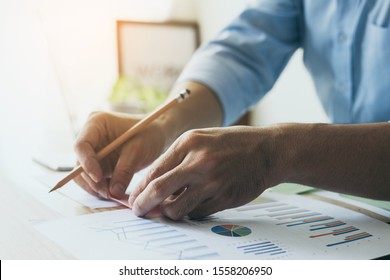 contact professional people thinking while working writing information documents in home offices at desk with computer,cell phone,business report chart