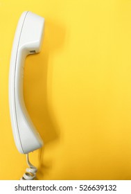 Contact Us and communivation Concept. Telephone with yellow isolated background