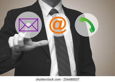 Contact us concept, businessman pressing contact button on virtual screen