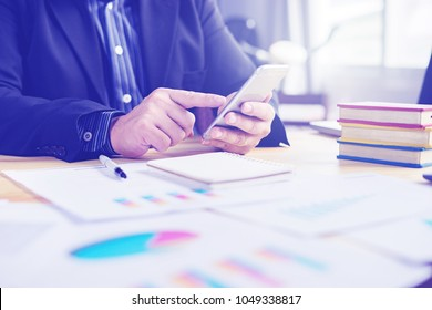 contact us concept,businessman working with modern devices, student boy using digital tablet computer and mobile smart phone,for business,selective focus,vintage color