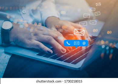 Contact us or Customer support hotline people connect. Businessman using a laptop computer with the (email, call phone, mail) icons.