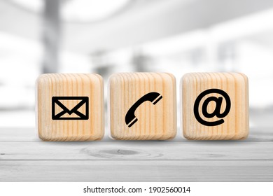 Contact us icon (phone, email, mail ) on wood cube, customer service and support