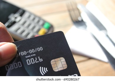 contactless payment card pdq background copy space with hand holding credit card ready to pay at cafe