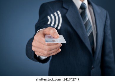 Contactless payment concept. Man pay with contactless credit card, virtual contactless symbol above card.