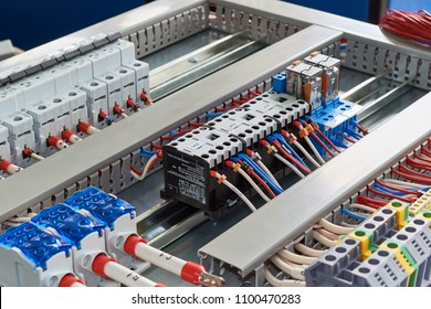 Contactors, relays, circuit breakers and terminals in the electrical Cabinet. Electrical wires or cables are connected to electrical equipment according to the project. Modern technologies, design.