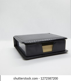 container in black leather and post it