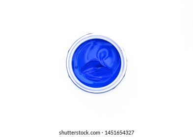 Container with blue gouache paint, isolated on a white background jar with cyan paint, a jar with blue sky cobalt paint, a container with blue paint top view, blue color, easy to apply to your design