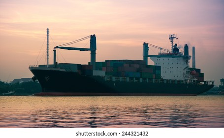 Container Cargo freight ship going to delivery destination in befor sunrise.