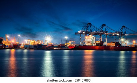Container Cargo freight ship with working crane bridge in shipyard at dusk for Logistic Import Export background