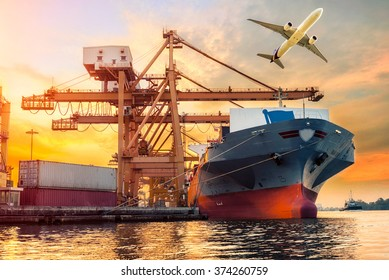 Container Cargo freight ship with working crane bridge in shipyard at sunrise for Logistic Import Export background