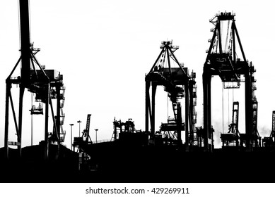 Container Cargo freight ship with working crane bridge in shipyard isolated on white background, Logistic Import Export background concept.