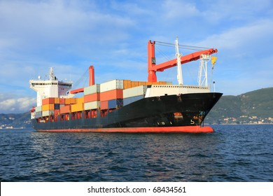 container cargo ship arriving in harbor