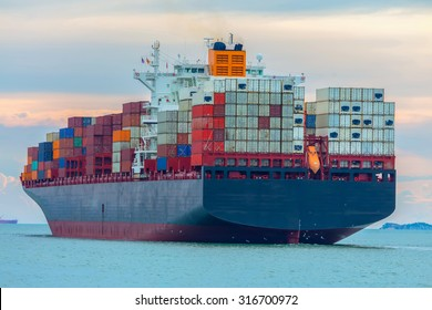 Container cargo ship carrying the tenor in the sea.