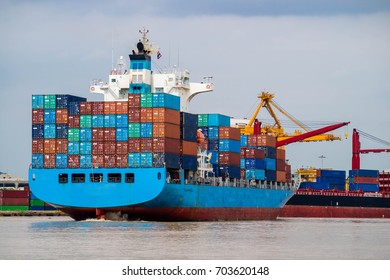 Container cargo ship depart from shipping port. Logistics industrial and import export transportation business background