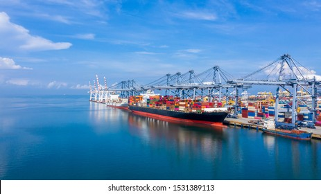 Container cargo ship at industrial port in import export business logistic and transportation, Container ship loading and unloading freight shipment, Aerial view container cargo boat freight ship.