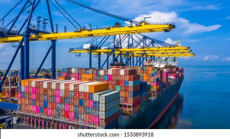 Container cargo ship at industrial port in import export commercial trade business logistic and transportation of international by container cargo ship boat in the open sea, Aerial view industry crane