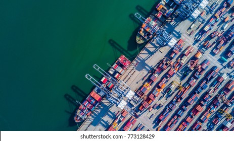 Container cargo ship loading at port, Freight transportation import export and business logistic by container ship, Aerial view.