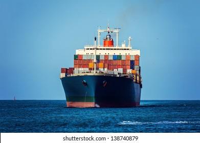 Container cargo ship in ocean.