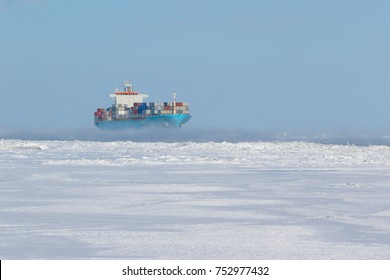 Container cargo ship on icy waters