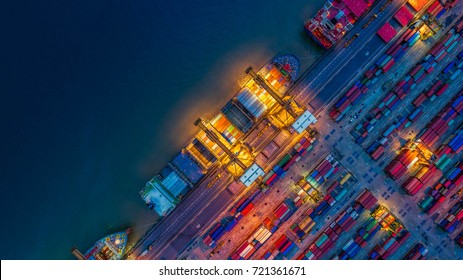 Container Cargo ship and Cargo plane with working crane bridge in shipyard at sunrise