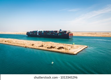 Container cargo ship sailing on Suez Canal