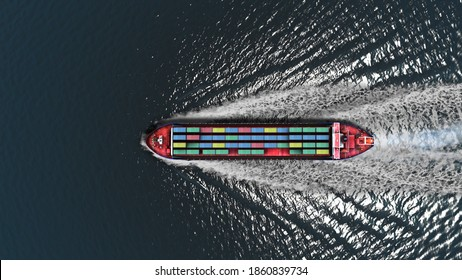 container cargo ship in the sea- Aerial Top down view, Freight Transportation, Shipping,Trade Port,Shipping cargo to harbor, Nautical Vessel  - Shutterstock ID 1860839734