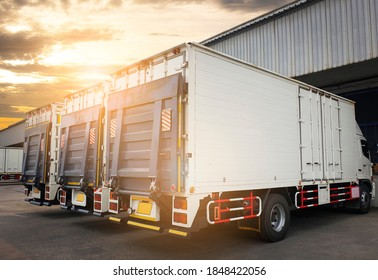 Container cargo truck parking at sunset sky in the warehouse.  Road freight cargo shipment. Logistics and transportation.
