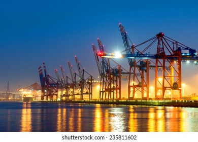 Container cranes in Hamburgs harbour at night