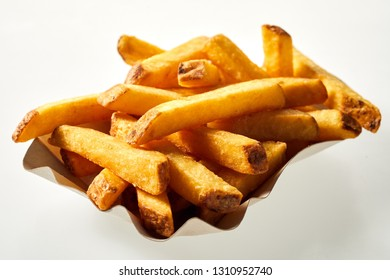 Container of crispy fried French Fries, Pommes Frites or potato chips as a takeaway or accompaniment to a meal over a white background