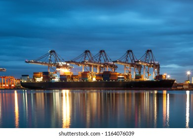 Container in export and import and Logistics and transportation of Container Cargo ship. Shipping cargo to harbor by crane, logistic import export and transport industry background
