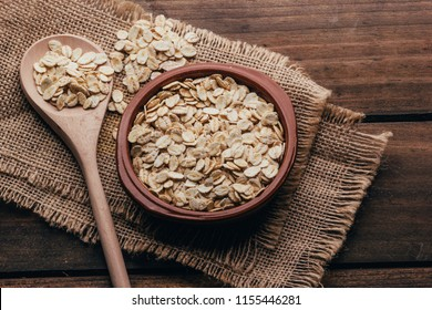 Container filled with uncooked oats, rustic style
