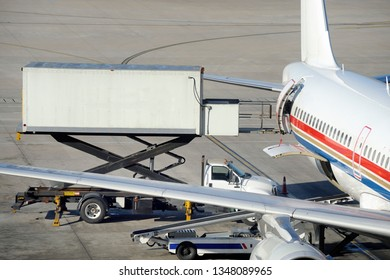 Container with food catering supplies for aircraft passengers being loaded onto a plane