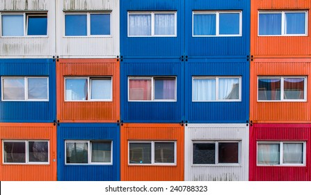 Container homes in red, white, orange and blue