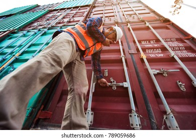 container inspector in surveying the condition of container before delivery shipment to the carrier or customers