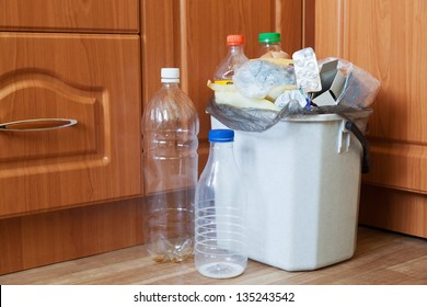Container of kitchen filled with garbage