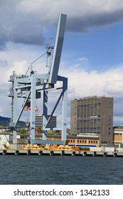 Container lifting gear at European container terminal, branding removed.