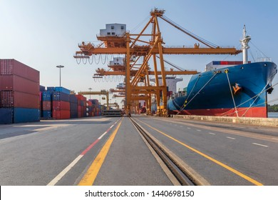 Container loading in a cargo freight ship with crane to shore lift up loading export containers box in import and export business logistic industry and transportation concept.