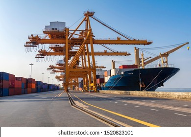 Container loading in a cargo freight ship with crane to shore lift up loading during cargo operation in the day time import and export  logistic and transportation concept.