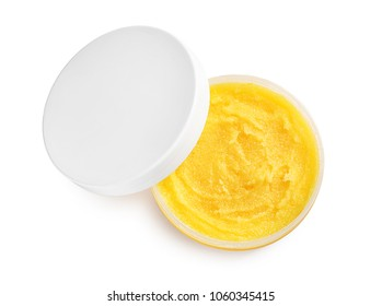 Container with natural scrub on white background, top view
