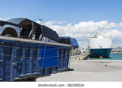 Container with scrapped car parked in the port